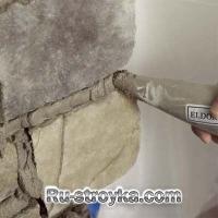 Как декорировать камин при помощи искусственного камня.